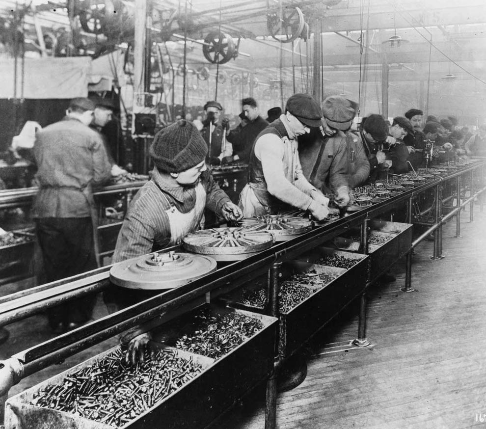 Workers on an assembly line, similar to a headless CMS.